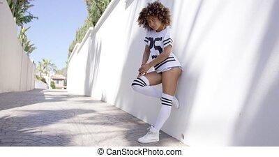Attractive female posing near white wall - Attractive female...
