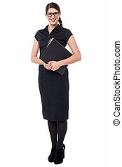 Attractive female secretary holding files