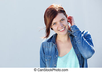 Attractive female smiling outdoors
