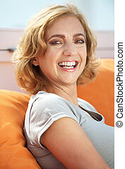 Attractive female smiling outdoors - Closeup portrait of an...