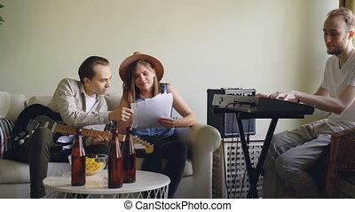 Attractive female vocalist and cheerful male guitarist are...