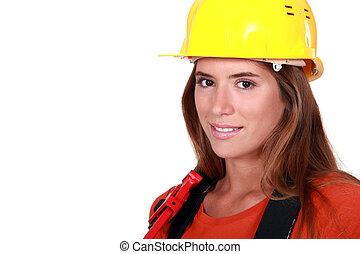 Attractive female worker holding wrench