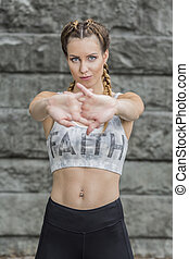 Attractive fit woman stretching her hands