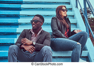 Portrait of an attractive stylish couple. An African-American man and Caucasian girl.