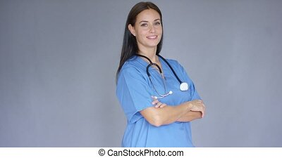 Attractive friendly young female doctor or surgeon wearing...