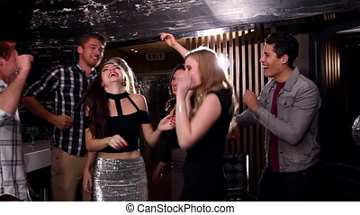 Attractive friends dancing together