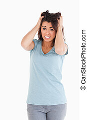 Attractive frustrated female standing