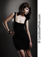 Attractive / Funky 60\\\'s retro woman on dark backround