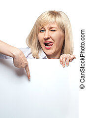 Attractive funny woman holding white empty paper and pointing on it isolated on white