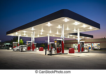 Horizontal shot of an attractive gas station convenience store at night.