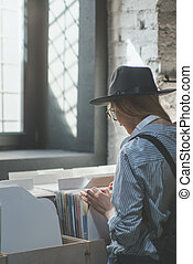 Attractive girl browsing vinyl records in a store