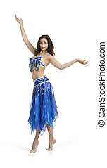 Attractive girl dances east dance on a white background.