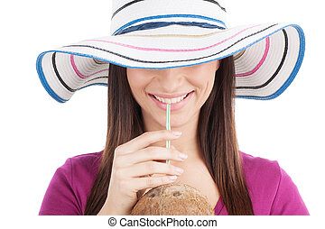 attractive girl drinking orange juice. closeup of brunette wearing hat and smiling