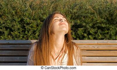 Attractive girl - happy. Good mood, summer, wind.