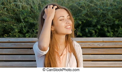 Attractive girl - happy. Good mood, summer wind