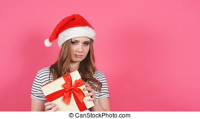 Attractive girl hold gift box in hands and showing different...