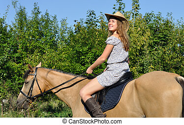 attractive girl horseback riding