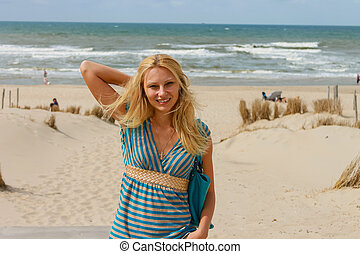 Attractive girl in a dress on the ocean