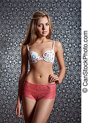 attractive girl in pink lingerie. - Sexy young woman with...