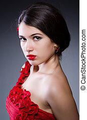 Attractive girl in red dress