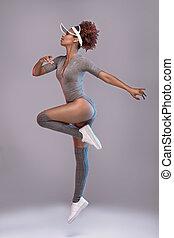 Attractive girl in studio jumping, posing.