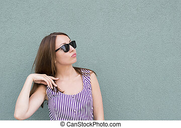 Attractive girl in summer dress with sunglasses