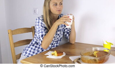 Attractive girl is eating a lemon pie