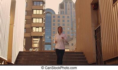 attractive girl jogging in urban city