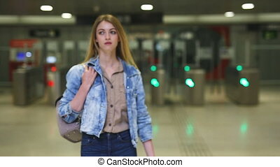 girl looking for convenient route on the subway map - ...