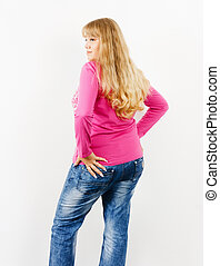Attractive girl posing standing - A girl in a pink jacket...