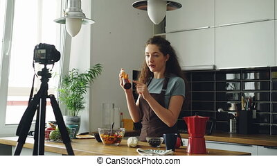 Attractive girl recording video food vlog about healthy...