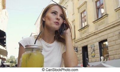 Attractive Girl Sitting in Street Cafe