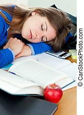 Attractive girl sleeping at her desk