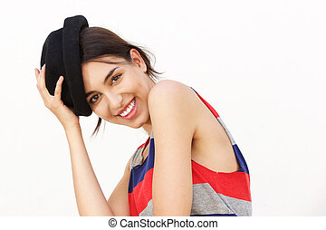 Attractive girl smiling with hat against white background
