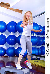 attractive girl stepping in a fitness center - healthy and...