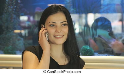 Attractive girl talking on a cellphone