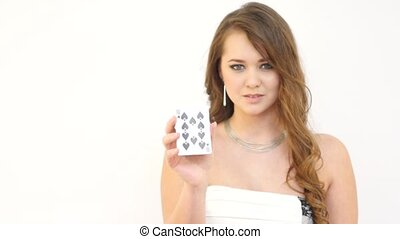 Attractive Girl Throwing Off Cards