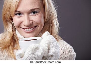 Attractive girl with a cup