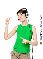 attractive girl with headphones on a white background in studio