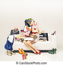 Attractive girl with heap of shoes - Attractive girl with...