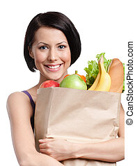 Health improving - Attractive girl with the packet of fruit...