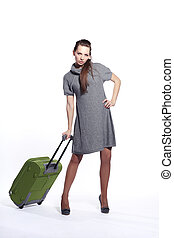 Attractive girl with the suitcase