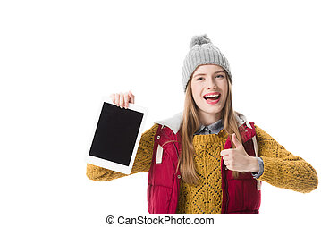 girl with thumb up presenting tablet