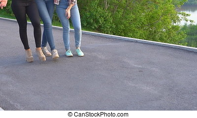 attractive girls having fun walking on the street. best friends spend time together and enjoy the meeting. Slow motion
