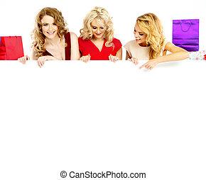 Attractive girls holding huge billboard