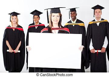 attractive graduate holding white board