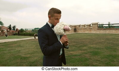 Attractive Groom Waiting for Bride