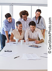 Attractive group of business people working together