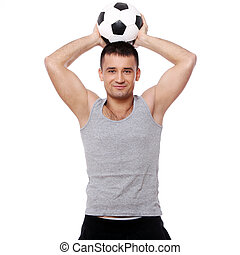 Attractive guy holding soccer ball