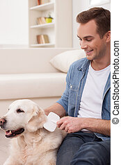 Attractive guy is caring of his dog